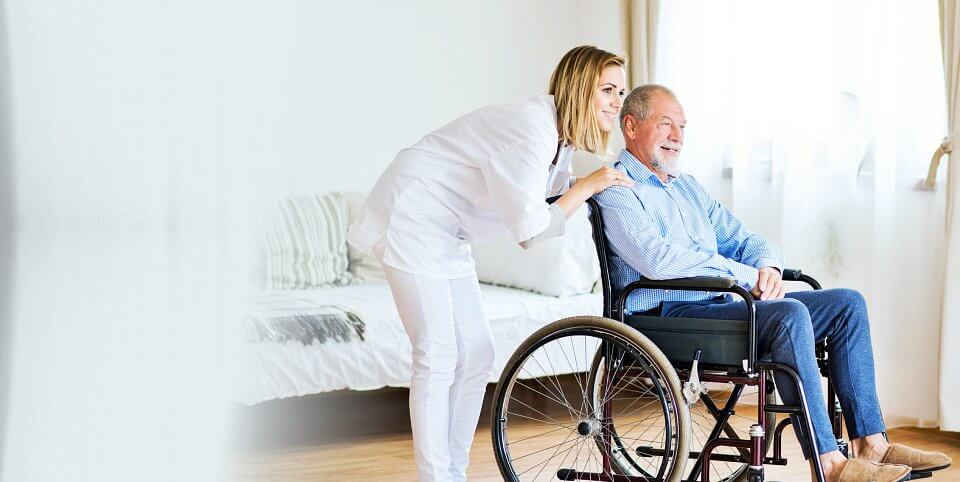 man on wheelchair and his caregiver