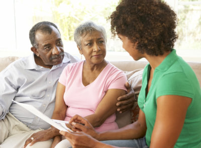 social worker talking to senior couple