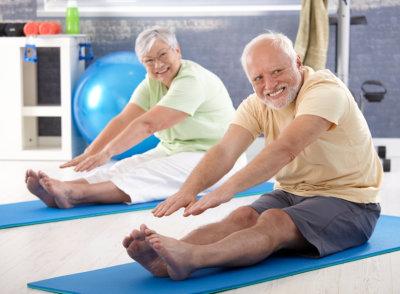 elderly couple stretching