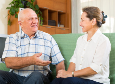 portrait of joyful mature couple gossiping together