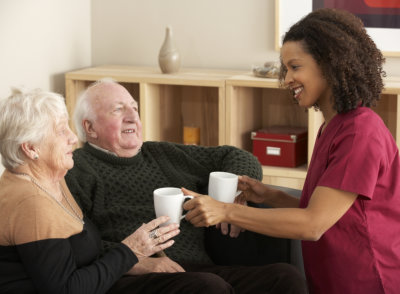 caregiver serving elderly a tea